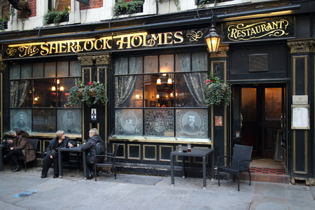 british food: London, England - January 24, 2015: People outside the Sherlock Holmes Pub in London, England. It was so named in 1957 when it became home to Sherlock Holmes exhibits from the Festival of Britain