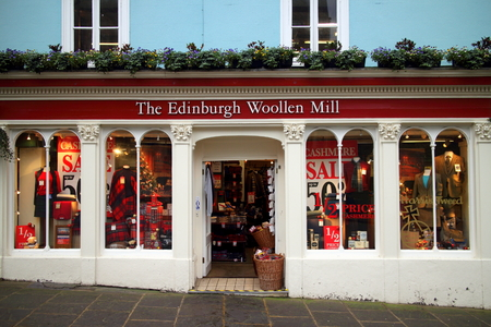 menswear: Windsor, England - January 01, 2015: The Edinburgh Woollen Mill store in Windsor, England. Founded by Drew Stevenson in 1946 there are now 265 high street outlets selling ladies and menswear in the UK Editorial