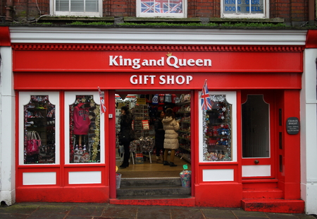 novelties: Windsor, England - January 01, 2015 Visitors inside the doorway of the King and Queen Gift Shop in Windsor, England. Annual visitor numbers to the town of Windsor are in excess of seven million