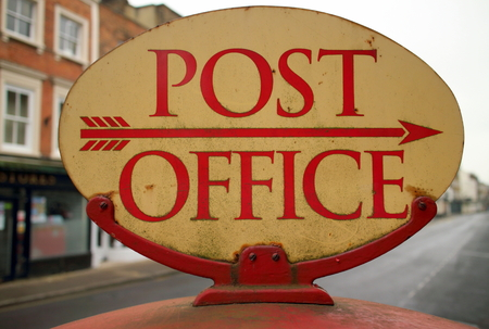 Stock Photo   Vintage Post Office Sign In The High Street Of A Town With An  Arrow Pointing In The Right Direction