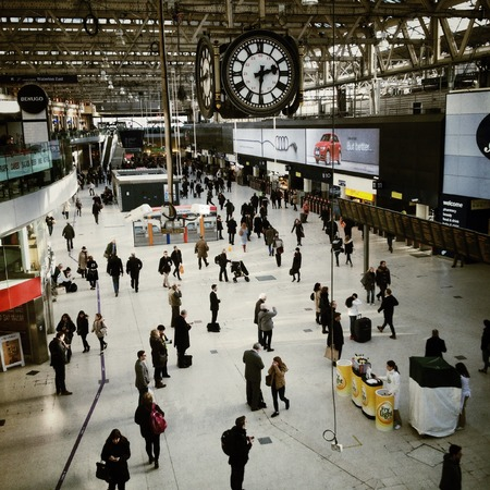 concourse: London, United Kingdom - February 17th, 2015: The busy concourse under the famous clock in Waterloo Railway Station in London, England. Based on people entering or leaving, Waterloo has almost 96m users per year.