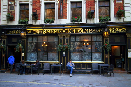 restaurant exterior: London, England - February 17, 2015: People outside the Sherlock Holmes Pub in London, England. It was so named in 1957 when it became home to Sherlock Holmes exhibits from the Festival of Britain Editorial