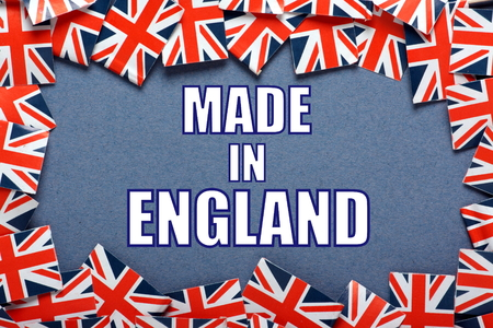 union jack: The phrase Made In England on a blue paper background with a border of Union Jack flags