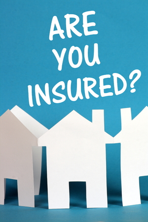 insured: The question Are You Insured above a chain of white paper houses on a blue background