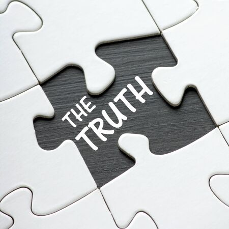 The phrase The Truth on a blackboard revealed by a missing jigsaw puzzle piece Standard-Bild