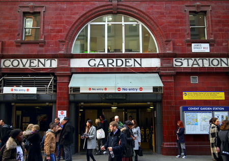 covent: London, England - March 17, 2015: People exiting and passing by the Covent Garden Underground Station in London, England. Covent Garden is visited by thirty million tourists each year.