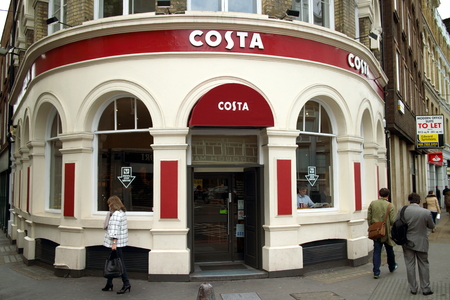 sergio: London, England - April 02, 2015: People passing by and in the window of a Costa Coffee Shop in Central London. Brothers Sergio and Bruno Costa started selling their coffee in London in 1971