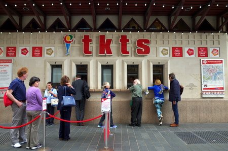discounted: London, England - April 16, 2015: Customers at the TKTS Ticket Office in Leicester Square, London. TKTS sells theater tickets at discounted prices and has operated in Leicester Square since 1980 Editorial