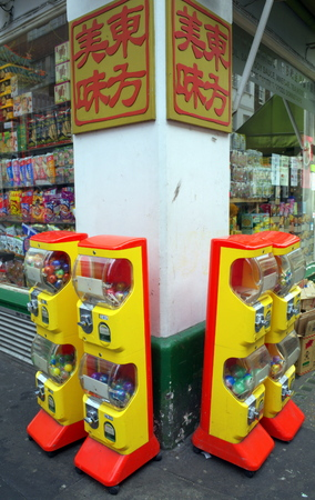 outside machines: London, United Kingdom - April 16, 2015: Four Capsule Toy vending machines standing outside a grocery store in the Chinatown district of London, England. Editorial