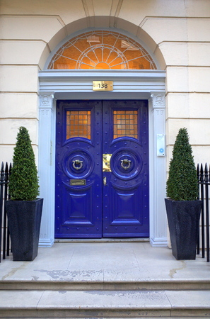 London England  April 30 2015: Typical Georgian entrance to the London Vision Clinic in Harley Street. London. Harley Street has a global reputation for private medical and health services