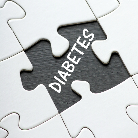 affliction: The word Diabetes revealed by a missing jigsaw puzzle piece Stock Photo