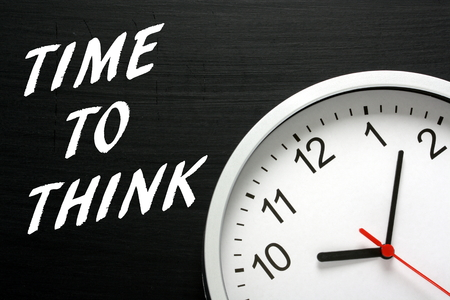 destress: The phrase Time To Think in white text on a blackboard next to a modern wall clock