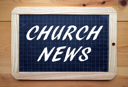 The phrase Church News in white text on a slate blackboard Standard-Bild