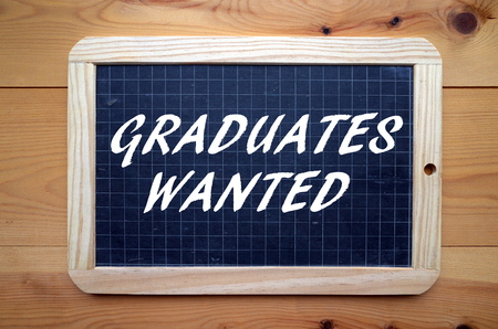 qualifications: The phrase Graduates Wanted in white text on a slate blackboard