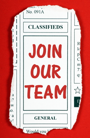 our team: Invitation to Join Our Team in red text on a newspaper clipping from the classified advertising section Stock Photo