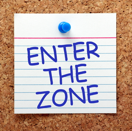 outcomes: The phrase Enter the Zone in blue text on a card pinned to a cork notice board. A state of min where full concentration enables optimum performance