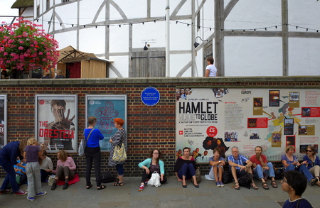globe theatre: London, England - August 20, 2015: People queuing for a performance at the Globe Theatre in London, England. A reconstruction of Shakespeares original, the theatre  opened for performances in 1997