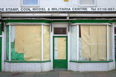 reported: Reading, United Kingdom - September 03, 2015: Empty retail unit with blocked out windows in Reading, England. The Local Data Company reported almost 10,000 vacant retail units in the UK in 2015