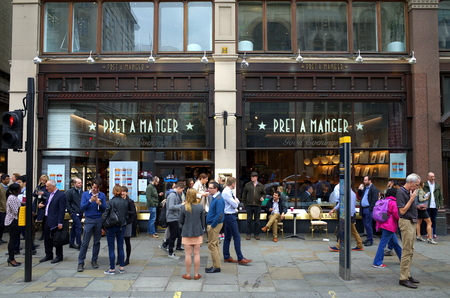 sidewalk: London, England - Sept 09, 2015: People crowd the pavement and can be seen inside a Pret A Manger store in London, England. Started in 1986, the food and drink vendor now has 350 stores worldwide