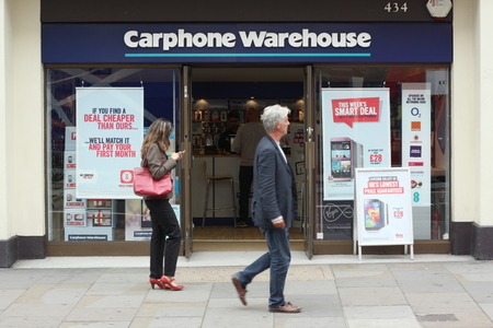 retailer: London, England - Sept 11th, 2014: People walking by the Carphone Warehouse store in Central London. The UK company was founded in 1989 as a mobile phone retailer by Sir Charles Dunstone