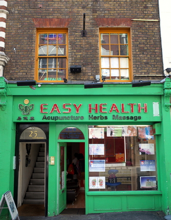 dispensary: London, England - Sept 09, 2015: Chinese Medicine Store with people inside in the Chinatown area of London. Traditional Chinese Medicine is a distinct and independent system more than 2000 years old.