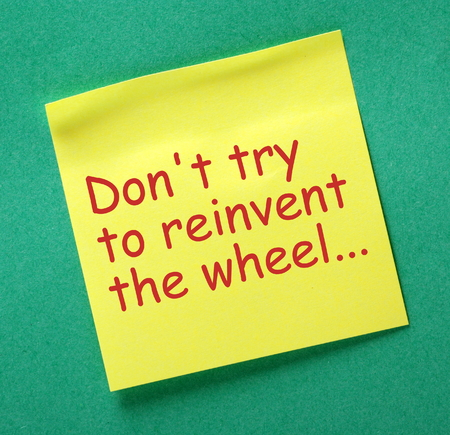 originality: The phrase Dont Try To Reinvent The Wheel in red text on a yellow sticky note as a reminder you dont have to invent a new product or service to start up in business