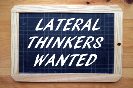 thinkers: The phrase Lateral Thinkers Wanted in white text on a blackboard as a recruitment message for people who think outside the box