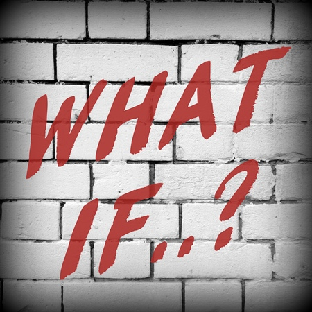 outcomes: The question What If in red text on a brick wall background processed in black and white for effect