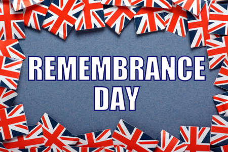 armistice: The phrase Remembrance Day in block letters on a blue background surrounded by a border of union jack flags of Great Britain