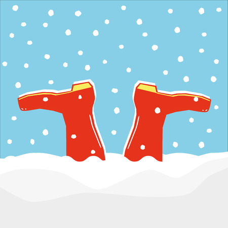 A pair of red wellington boots or galoshes stuck upside down in a drift made by falling snow