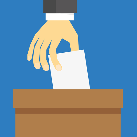 brown box: Hand in suit sleeves placing a white card or ballot paper into a brown box to cast their vote