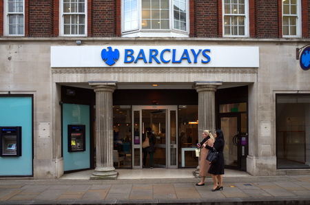 uk money: London, England - February 04, 2016: People passing by or entering Barclays Bank in Richmond, London. Barclays provide services for an estimated 48m customers and clients worldwide