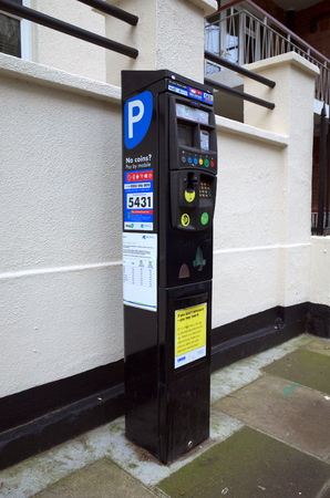 enabled: London, England - February 04, 2016: Parking meter in Richmond, London with the Ringo enabled service, allowing payment by mobile phone using their application alongside traditional payment methods Editorial