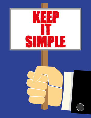 concise: Hand in a business suit holding up a placard or small notice board with the words Keep It Simple added in red text