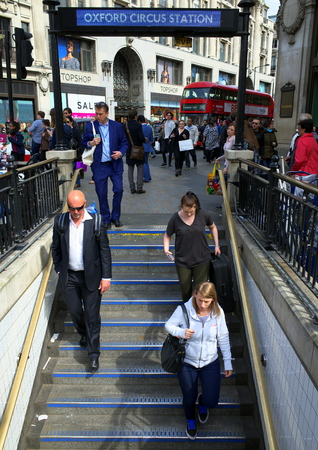 London, England - April 16, 2015: People descending the entrance staircase at Oxford Circus Underground Train Station in the shopping district of Oxford Street in London
