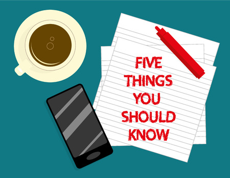 The phrase Five Things You Should Know in red text on lined notepaper with a cup of coffee, smartphone and marker pen on a desktop