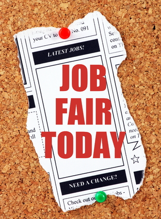 bulletin: Newspaper clipping from the classified advertising section with the words Job Fair Today in red text and pinned to a cork notice board