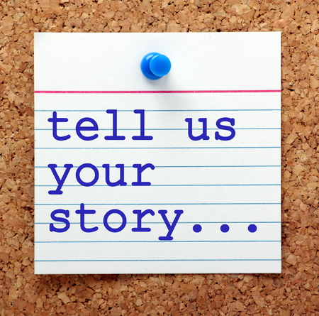 The words tell us your story in blue text on a note card pinned to a cork notice board as a reminder for you to prepare your career history and experience