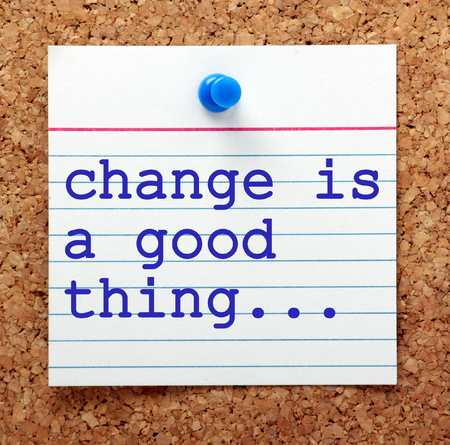 note board: The phrase Change is a Good Thing on a note card pinned to a cork notice board as a reminder to embrace change and the opportunities it can offer Stock Photo