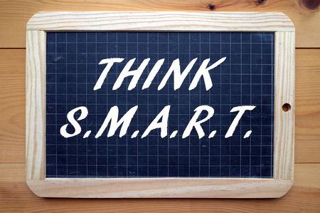outcomes: The words Think SMART on a blackboard. The business acronym for project planning and change management that stands for Specific, Measurable,Achievable, Relevant and Time-bound