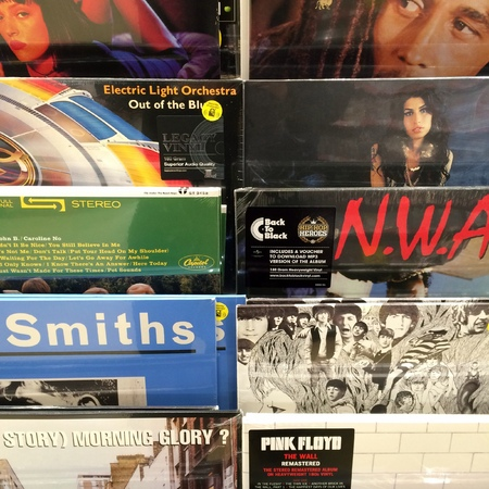 famous industries: London, England - October 08, 2016:Collection of vinyl record covers by famous bands and performing artists in the music industry on display at a stand Editorial