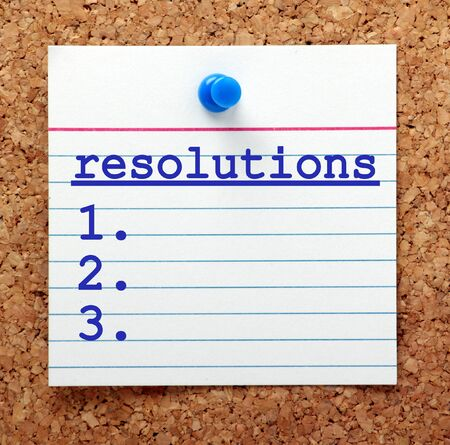 note board: List of Resolutions on a note card pinned to a cork notice board as a reminder of your plans to make changes in the New Year Stock Photo