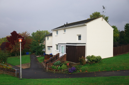 grass verge: Bracknell,England - October 25, 2016: Homes on a housing estate in Bracknell, England after a shower of rain on a grey day. Typically, estates in the area are a mixture of private and social housing