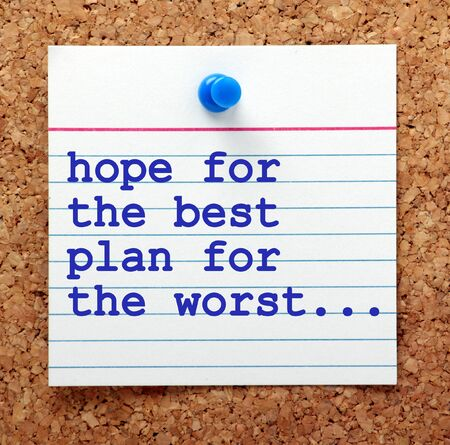 disaster recovery: The phrase Hope for the Best and Plan for the Worst in blue text on a note card pinned to a cork notice board as a reminder to be prepared for events Stock Photo
