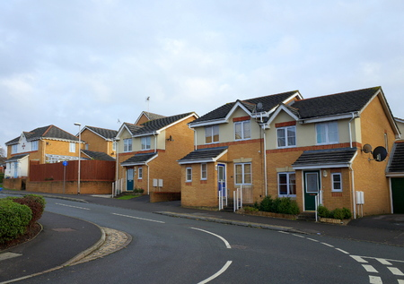 detached houses: Bracknell,England - November 23, 2016: A row of brick built homes on a modern housing estate beside a road in Bracknell, England