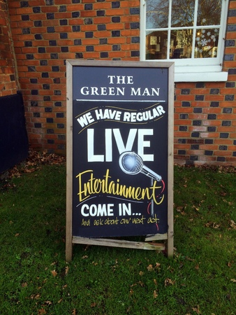 entertainment event: Bracknell,England - December 26, 2016: Blackboard sign outside The Green Man public House advertising regular live entertainment for visitors