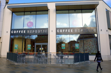 shop sign: Bracknell, England - February 20, 2017: A pedestrian passes by the Coffee Republic shop in Bracknell,England. Started in 1995 they now have 28 stores across the UK Editorial