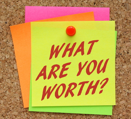 self worth: The question What Are You Worth in red text on a yellow sticky note as a reminder to assess your value in terms of financial rewards
