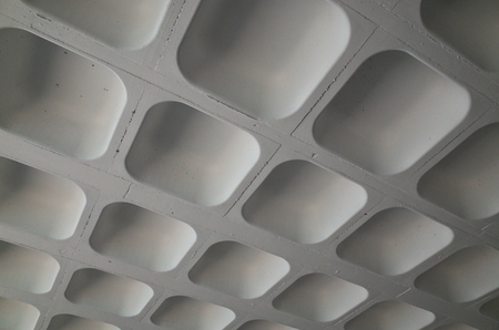 The molded concrete ceiling of a car park photographed to provided an abstract background Stock fotó