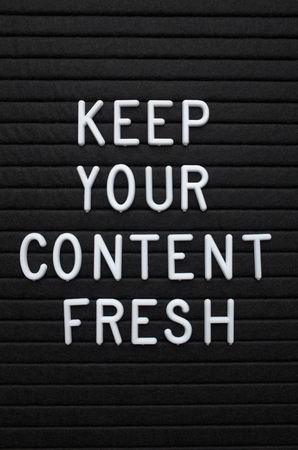 The phrase Keep Your Content Fresh in white plastic letters on a letter board as a reminder to update your marketing and social media platforms Stock Photo